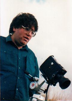 Bill Mousoulis in 1988 with a Super 8 camera.